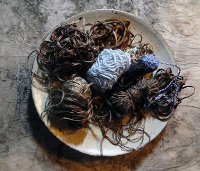 Plate of yarn to be made into textiles